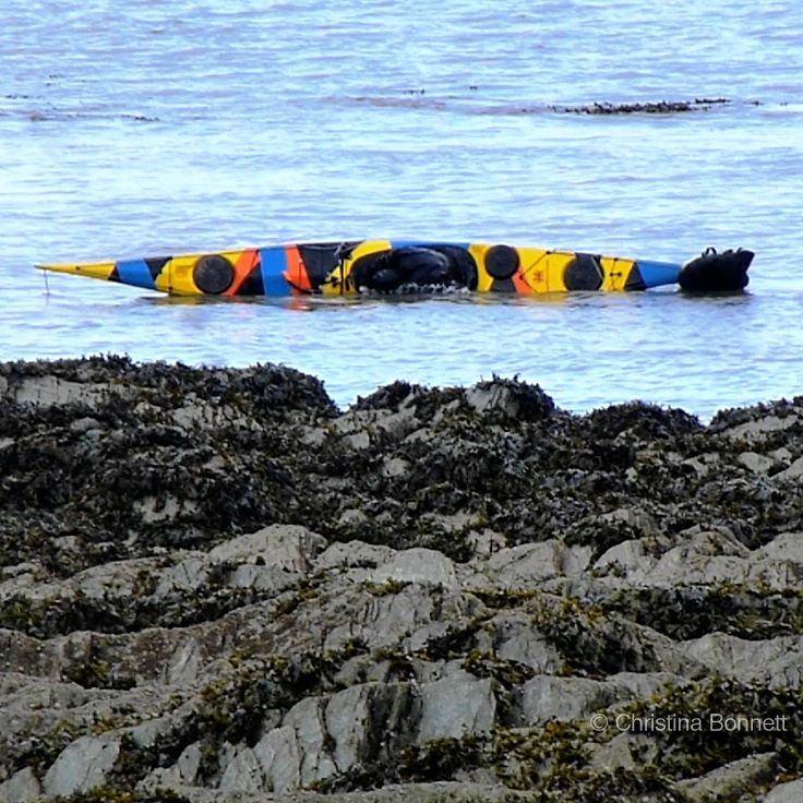 Greenland roll in Dazzle Painted Kayak
