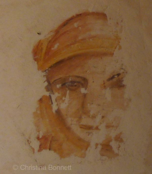 Fresco face in plaster