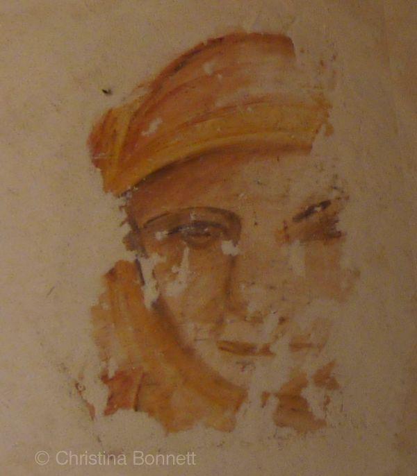 Fresco face in plaster